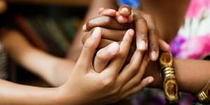 o-WOMEN-HOLDING-HANDS-facebook